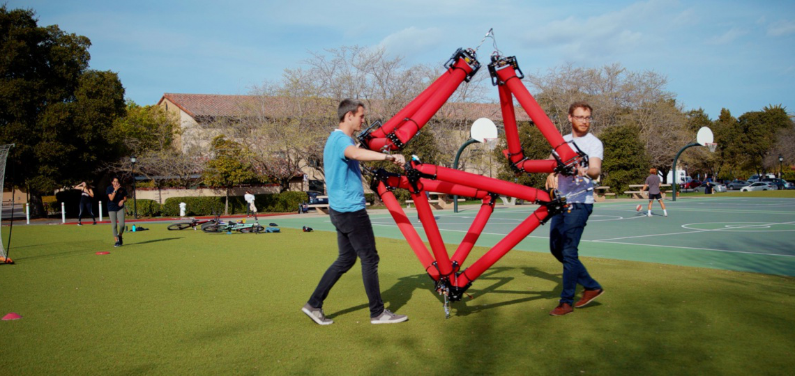 Graduate students Zachary Hammond, left, and Nathan Usevitch with the isoperimetric robot