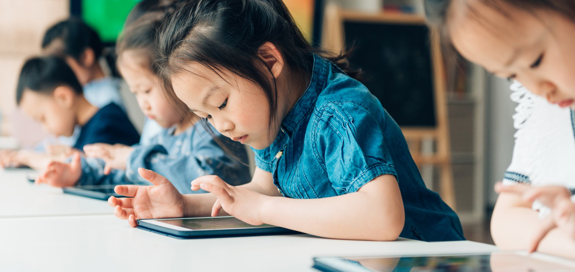 Children using technology to learn