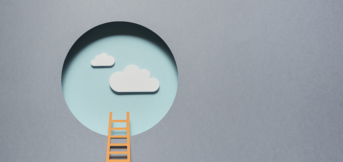 A cut paper illistration of an orange ladder leading up to a circular hole in a grey wall, leading to clear blue skies with fluffy white clouds