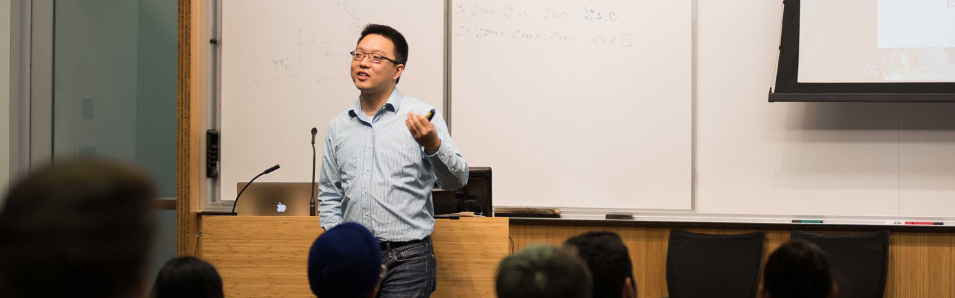 "Professor Lei ""Stanley"" Qi dialoging with his students in class."